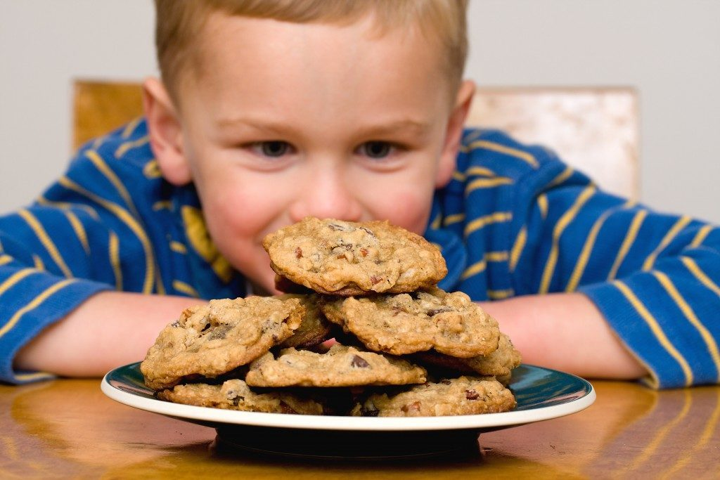 Child looking at chocolate chip cookies