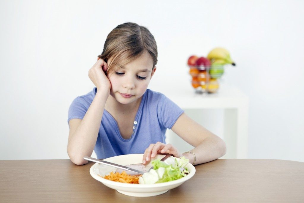 Little girl with eating disorder