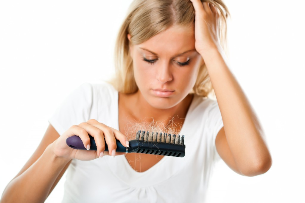 Blonde girl worried about hair loss
