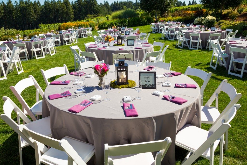 Tables, chairs, decor, and decorations at a wedding reception at an outdoor venue