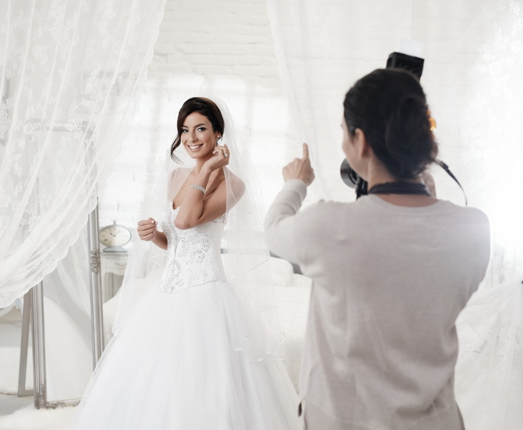 photographer taking photo of a bride