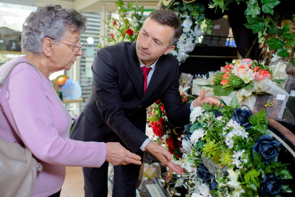 old woman talking to funeral director