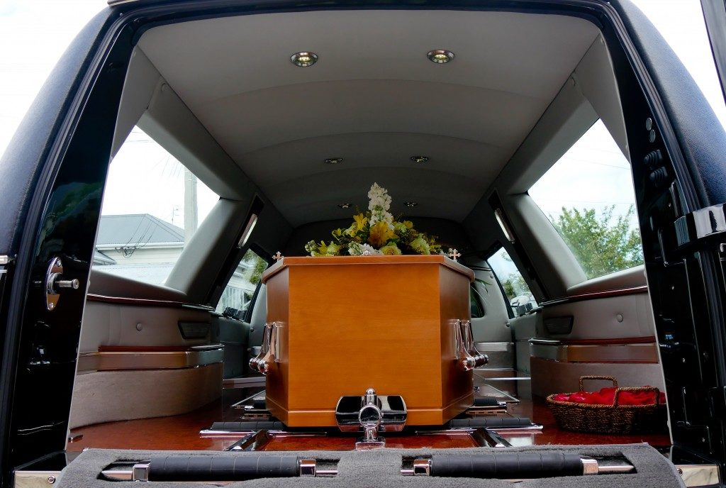 coffin inside a funeral car