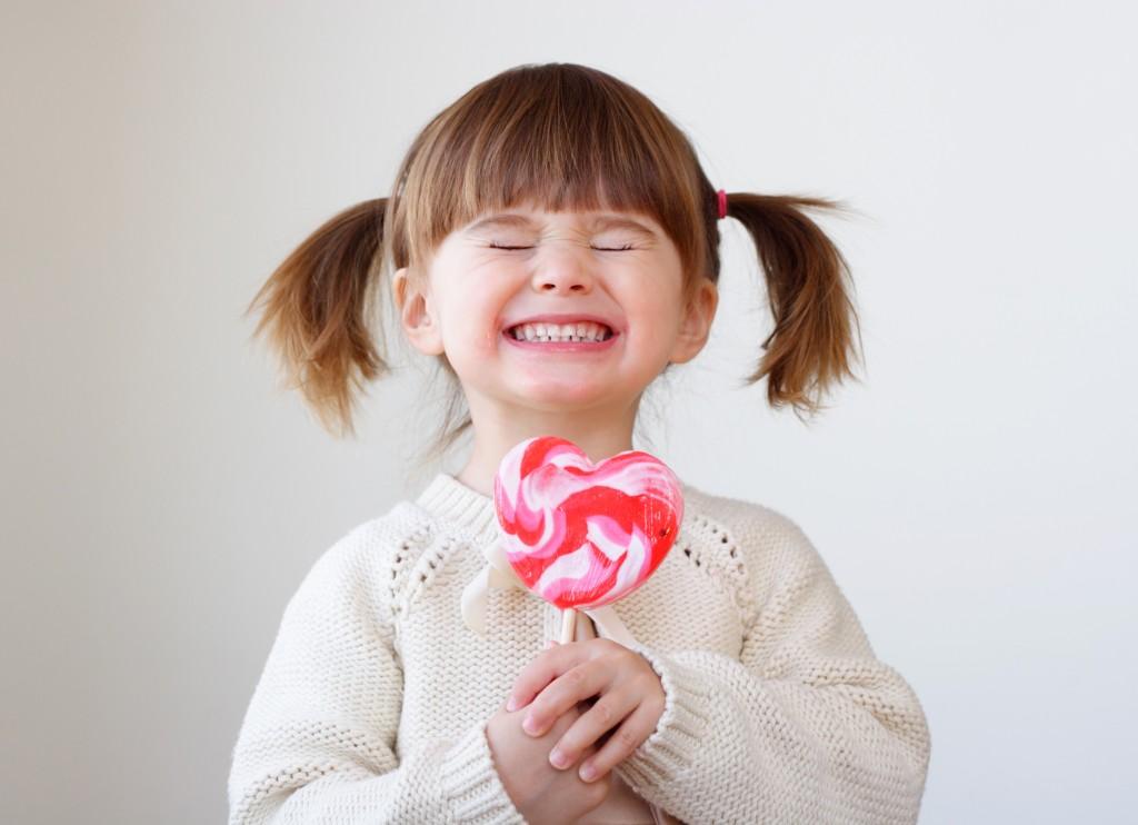 Child holding a lollipop