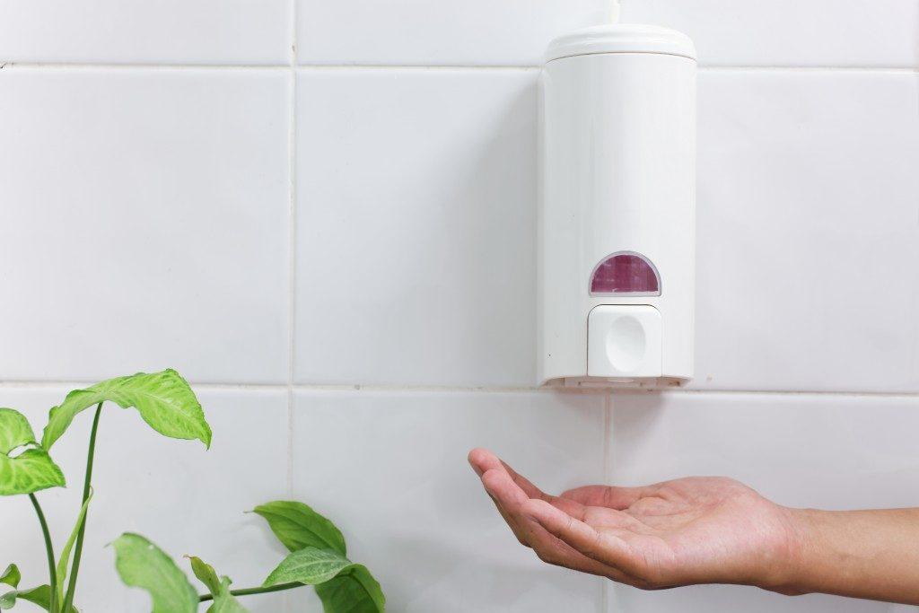 hand getting hand sanitiser