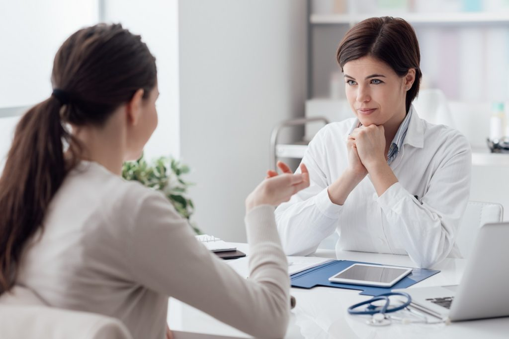 Woman consulting with a doctor