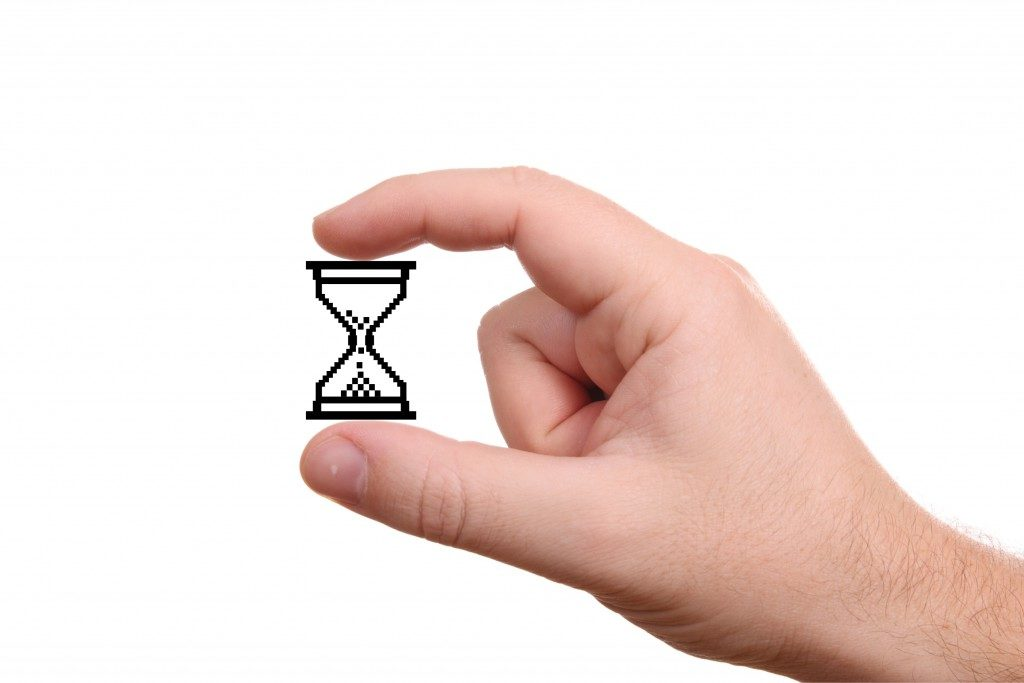 hand holding a digitalized hourglass