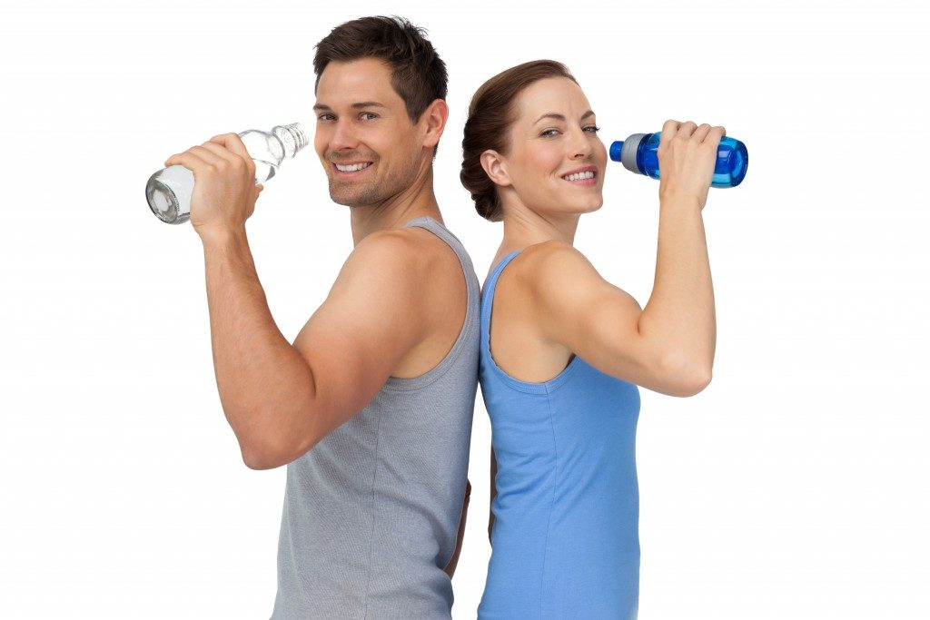Fit couple drinking water