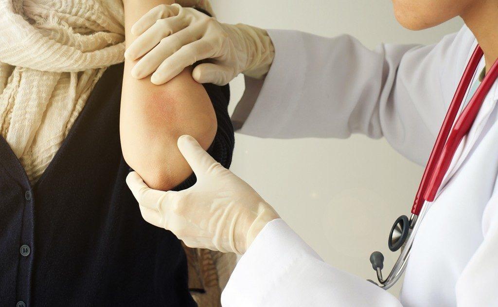 Dermatologist checking the skin