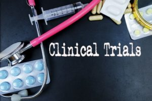Clinical Trials word with medical supplies