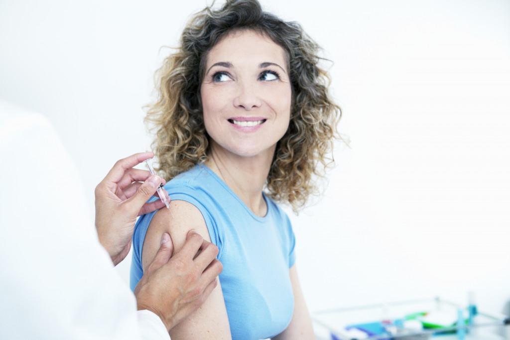 Female getting a vaccine shot
