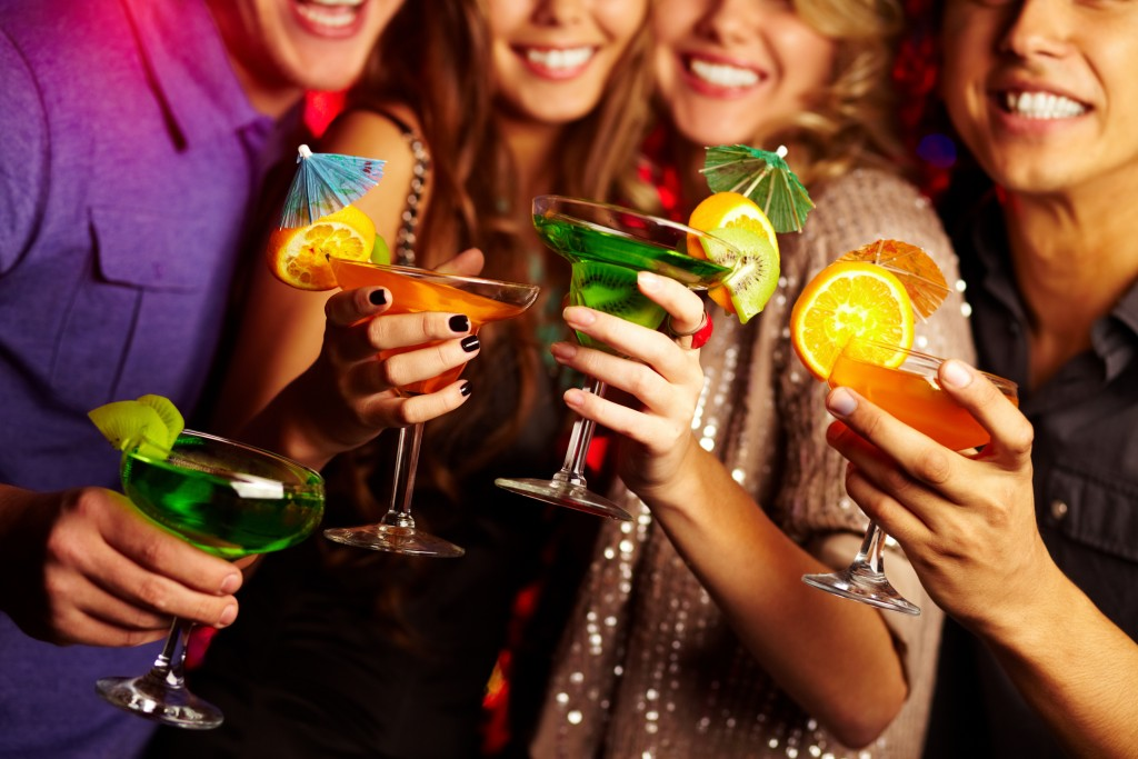 group of friends with cocktails