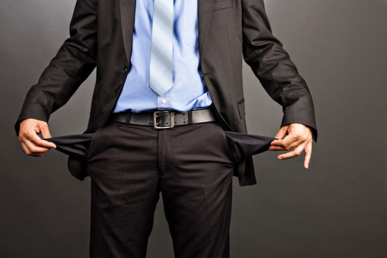 wearing corporate attire and showing empty pockets