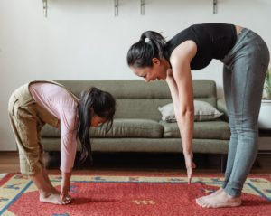 mom and daughter stretching