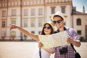 Couple on vacation looking at a map