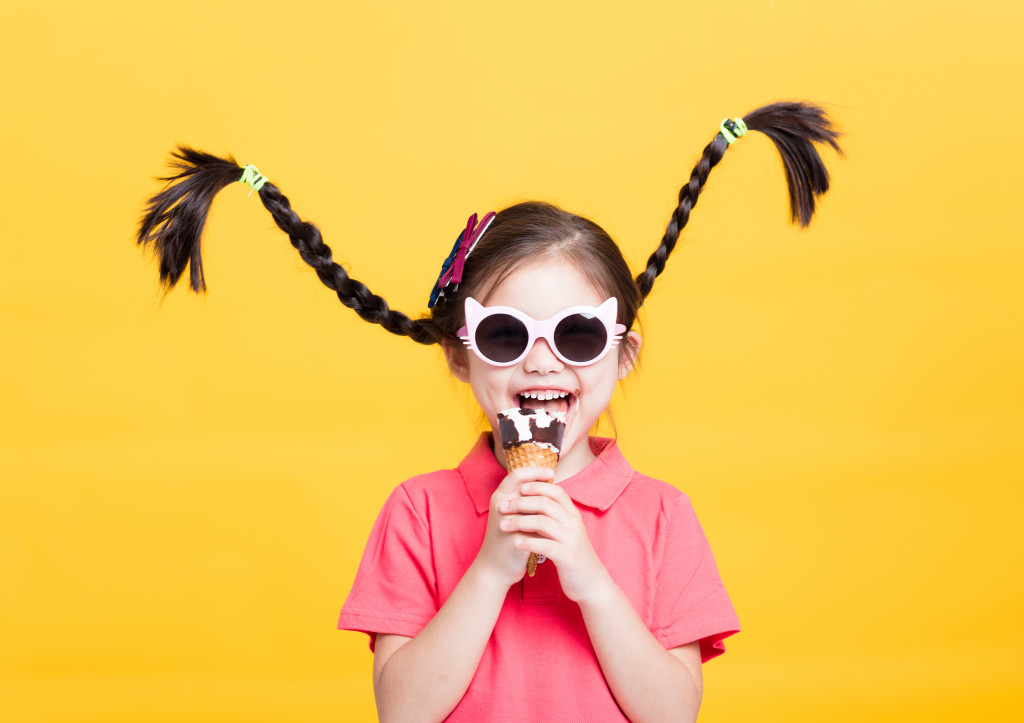child with pigtails